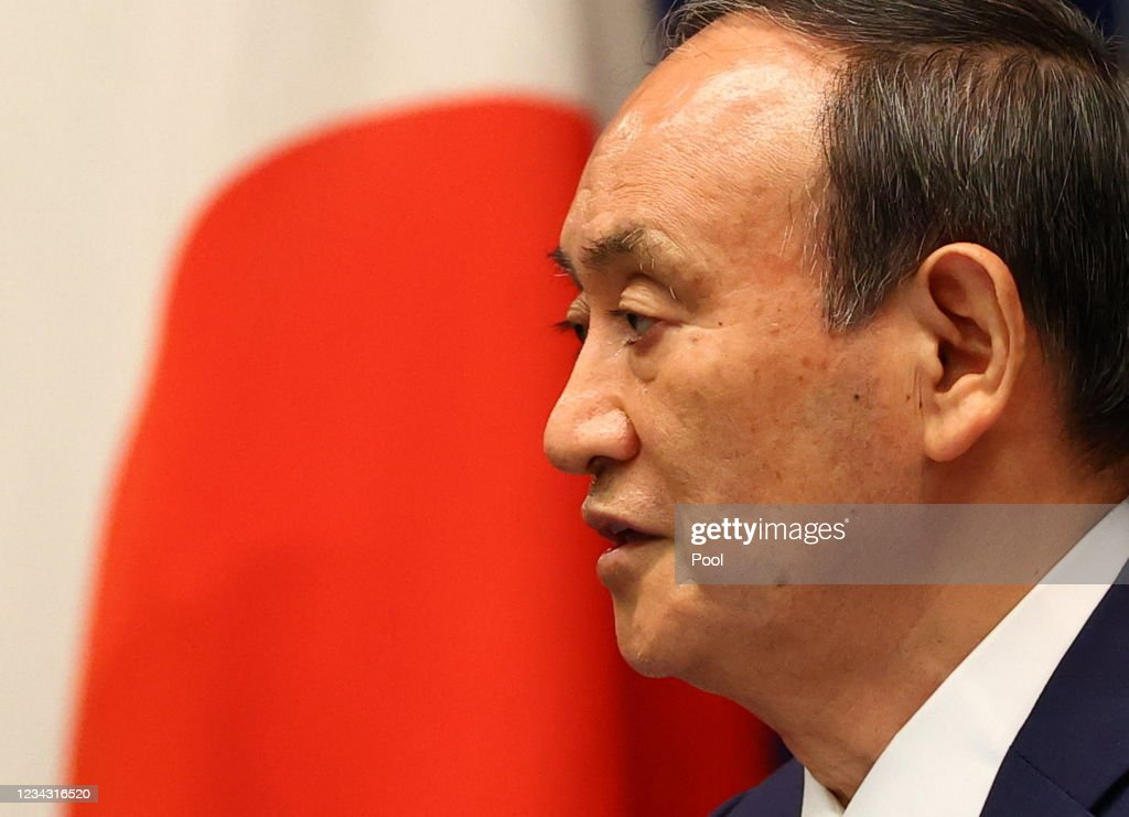 Japan's Prime Minister Holds Weekly Press Conference As Coronavirus Cases Surge In Tokyo : News Photo