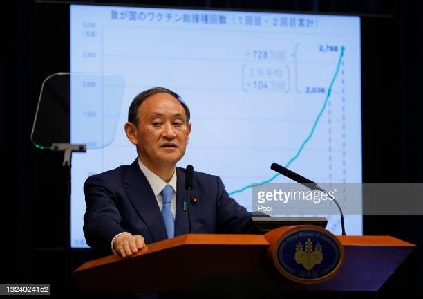 Japan's Prime Minister Yoshihide Suga attends a news conference on Japan's response to the coronavirus disease outbreak at his official residence on...