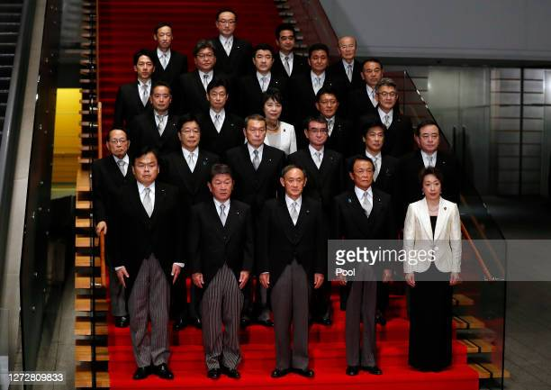Japan's Prime Minister Yoshihide Suga attends a photo session with his cabinet members at the prime minister's official residence on September 16,...