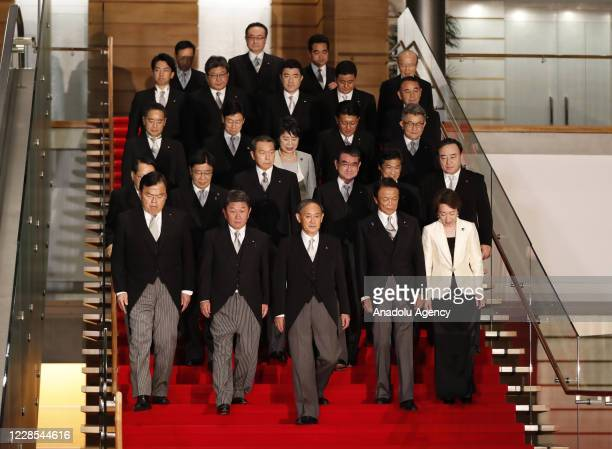 Japan's Prime Minister Yoshihide Suga leads his cabinet ministers prepare for a photo session at Suga's official residence in Tokyo Japan September...