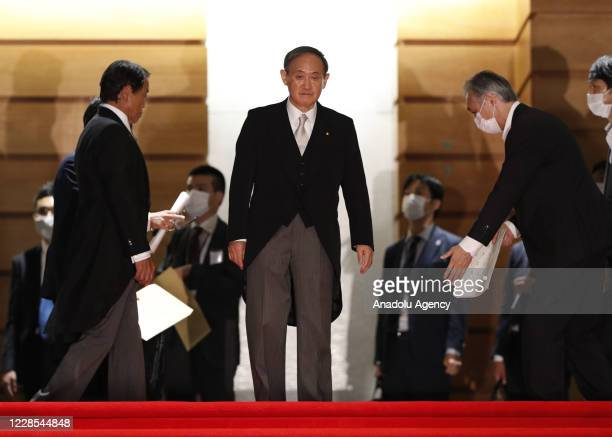 Japan's Prime Minister, Yoshihide Suga prepares for a photo session with other cabinet ministers at Suga's official residence in Tokyo, Japan,...