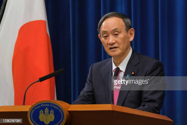 Japan's Prime Minister Yoshihide Suga speaks during a press conference on December 25, 2020 in Tokyo, Japan. Mr Suga urged people to be cautious...