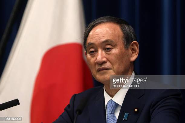 Japan's Prime Minister Yoshihide Suga speaks during a press conference at the prime minister's official residence in Tokyo on May 28 as the...