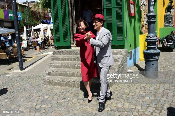Japan's Prime Minister's wife Akie Abe dances tango during her visit at La Boca neighbourhood in Buenos Aires on the sidelines of the G20 Summit on...