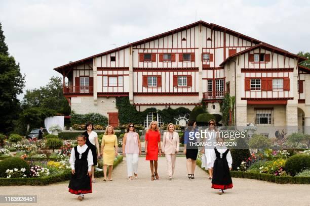 Japan's Prime Minister's wife Akie Abe European Council President's wife Malgorzata Tusk Australia's Prime Minister's wife Jenny Morrison wife of...