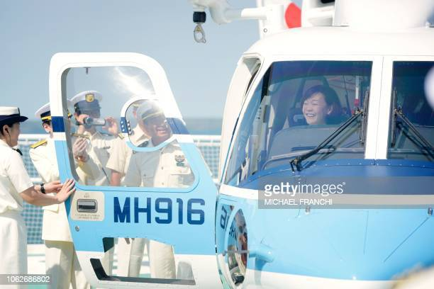 Japan's Prime Minister's wife Akie Abe sits inside a helicopter during a ship tour of the Japan Coast Guard vessel PLH08 Echigo at Fort Hill Wharf in...