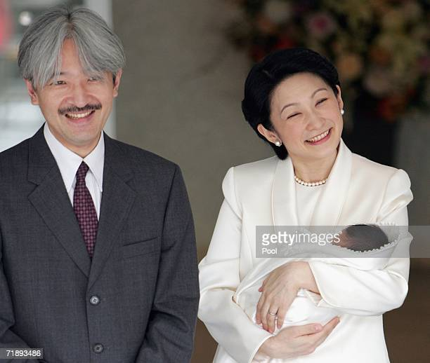 Japan's Prince Akishino and his wife Princess Kiko smile at as they leave a Tokyo hospital with their newborn son Prince Hisahito September 15 2006...