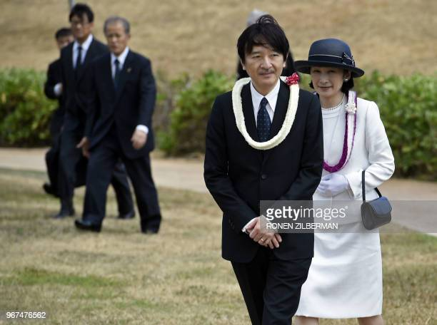 Japan's Prince Akishino and Princess Kiko arrive to pay their respects at the Ehime Maru Memorial in Kaka'ako Park in Honolulu Hawaii on June 4 2018...