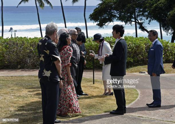 Japan's Prince Akishino and Princess Kiko greet members of the JapanAmerica Society of Hawaii as they arrive to pay their respects at the Ehime Maru...