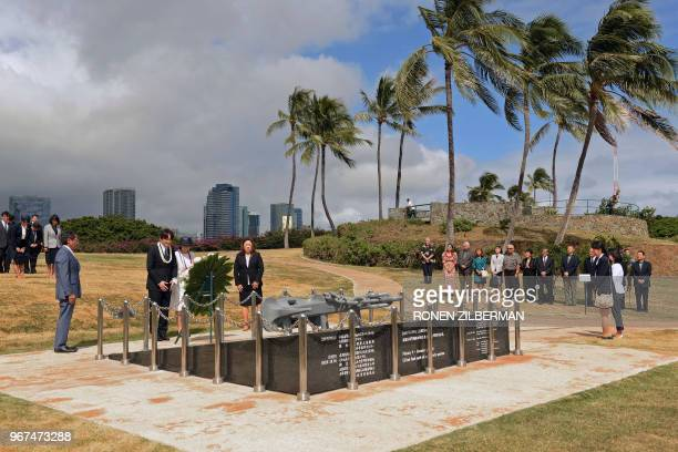 TOPSHOT Japan's Prince Akishino and Princess Kiko lay a wreath at the Ehime Maru Memorial in Kaka'ako Park in Honolulu Hawaii on June 4 2018 The...
