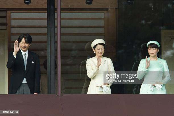 Japan's Prince Akishino his wife Princess Kiko and their daughter Princess Mako greet the public at the Imperial Palace on his 78th birthday on...