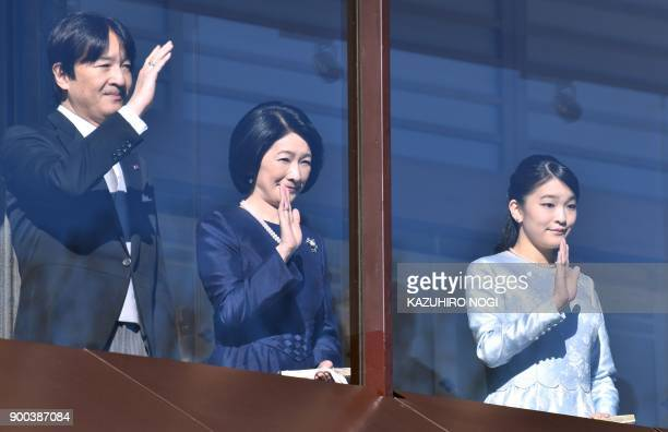 Japans Prince Akishino Princess Kiko and their daughter Princess Mako wave during the royal family's annual New Year's greeting to wellwishers...