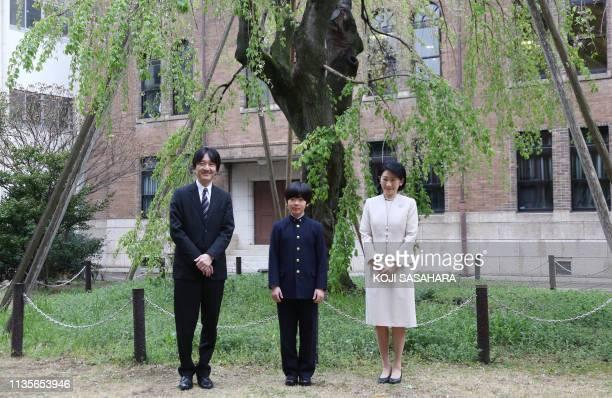 Japan's Prince Hisahito , accompanied by his parents Prince Akishino and Princess Kiko , poses for photos at Ochanomizu University junior high school...