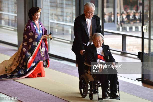 Japan's Prince Hitachi leaves at the end of the enthronement ceremony where Emperor Naruhito officially proclaimed his ascension to the Chrysanthemum...