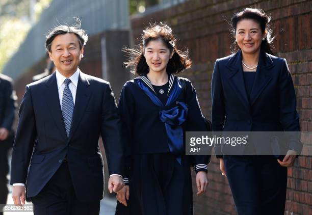 Japan's Princess Aiko , accompanied by her parents Crown Prince Naruhito and Crown Princess Masako, arrives at her graduation ceremony at the...