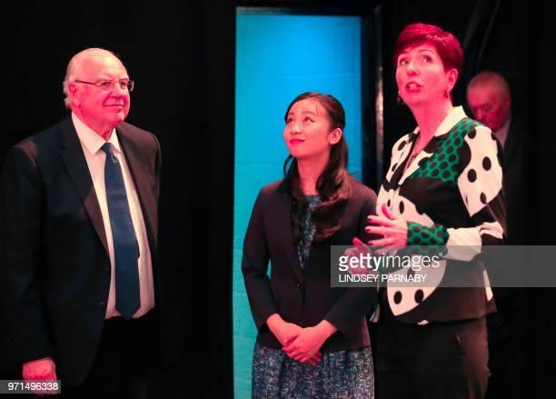Japan's Princess Kako the daughter of Japan's Prince Akishino and Princess Kiko speaks with University of Leeds ViceChancellor Alan Langlands and the...