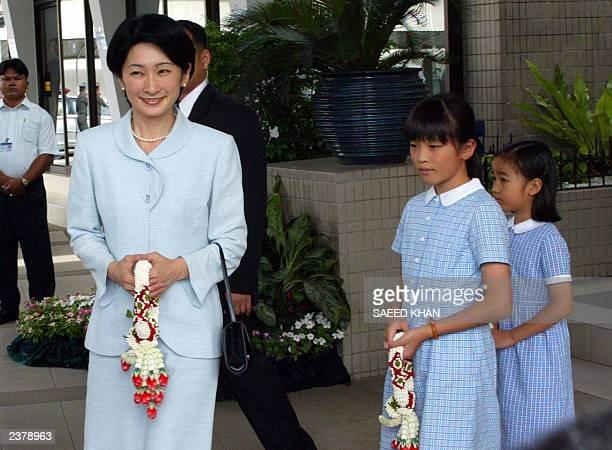 Japan's Princess Kiko along with Princess Mako and Princess Kako leave VIP lounge upon their arrival at the Bangkok international airport 07 August...