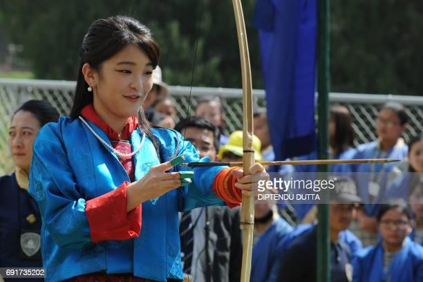 Japan's Princess Mako attempts to shoot an arrow at the Changlingmethang National Archery ground in Thimphu on June 3 2017 Japan's Princess Mako the...