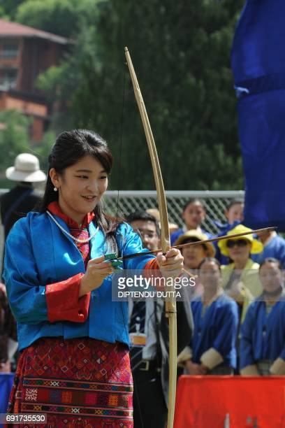 Japan's Princess Mako attempts to shoot an arrow at the Changlingmethang National Archery ground in Thimphu on June 3, 2017. Japan's Princess Mako,...