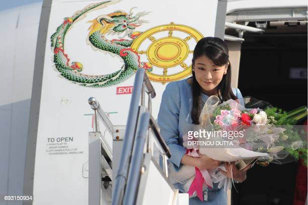 Japan's Princess Mako bows prior to her departure from Paro Airport in Bhutan on June 7 2017 Japan's Princess Mako the oldest of Emperor Akihito's...