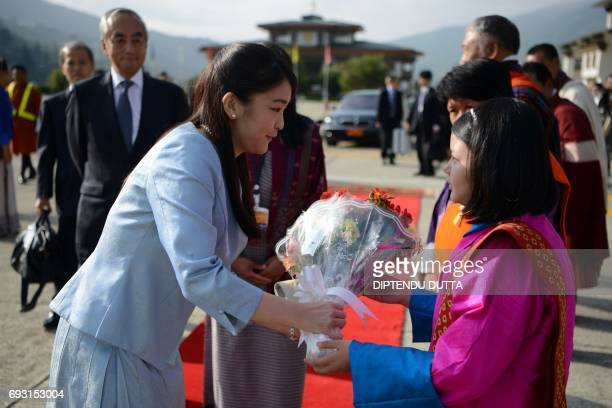 Japan's Princess Mako receives a bouquet of flowers from a Bhutanese delegate prior to her departure from Paro Airport in Bhutan on June 7, 2017....