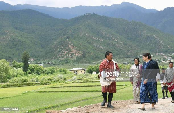 Japan's Princess Mako the granddaughter of Emperor Akihito and Empress Michiko visits a paddy field in the western Bhutanese town of Paro on June 5...