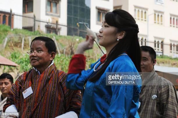 Japan's Princess Mako throws a traditional dart called a khuru at the Changlingmethang National Archery ground in Thimphu on June 3, 2017. Japan's...