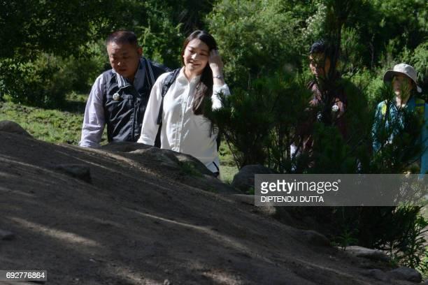 Japan's Princess Mako walks to Taktsang Monastery on the outskirts of Paro on June 6 2017 Princess Mako the oldest of Emperor Akihito's grandchildren...