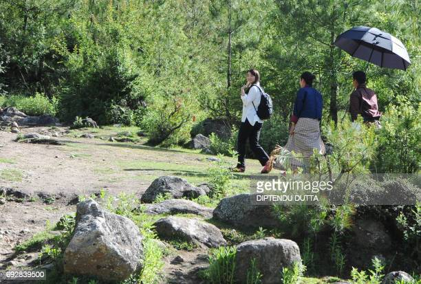 Japan's Princess Mako waves as she walks to Taktsang Monastery on the outskirts of Paro on June 6 2017 Princess Mako the oldest of Emperor Akihito's...
