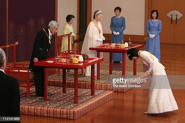Japan's Princess Sayako bows Emperor Akihito and Empress Michiko during a traditional 'Chokennogi' ceremony Princess's last rite as a member of the...