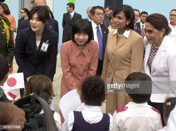 Japan's Princess Sayako greets some students of the Renacimiento school upon her arrival at the Sula Museum in San Pedro Sula 240kms north from...