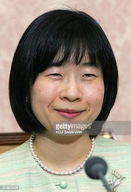 Japan's Princess Sayako smiles during a press conference with Yoshiki Kuroda , a Tokyo city bureaucrat, aged 39, regarding their engagement at the...