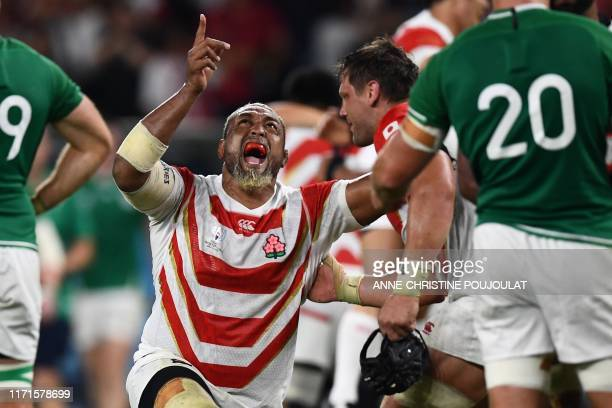 TOPSHOT Japan's prop Isileli Nakajima celebrates after winning the Japan 2019 Rugby World Cup Pool A match between Japan and Ireland at the Shizuoka...