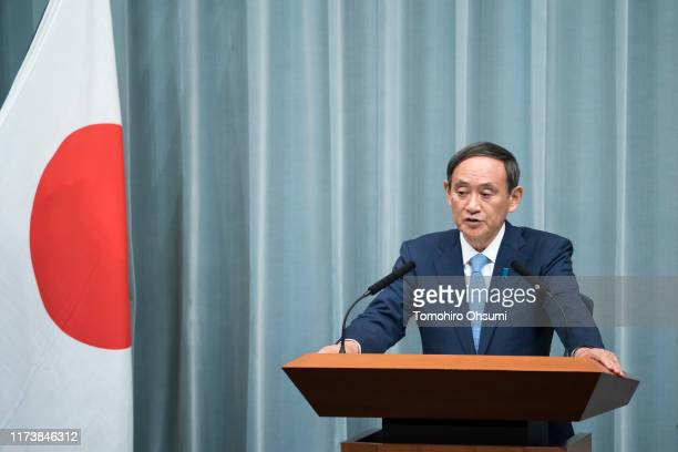 Japan's reappointed Chief Cabinet Secretary Yoshihide Suga speaks during a press conference at the prime minister's official residence on September...