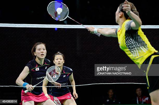 Japan's Reika Kakiiwa and Miyuki Maeda compete against China's Wang Xiaoli and Yu Yang during the women's double semi final match at the 2014 BWF...