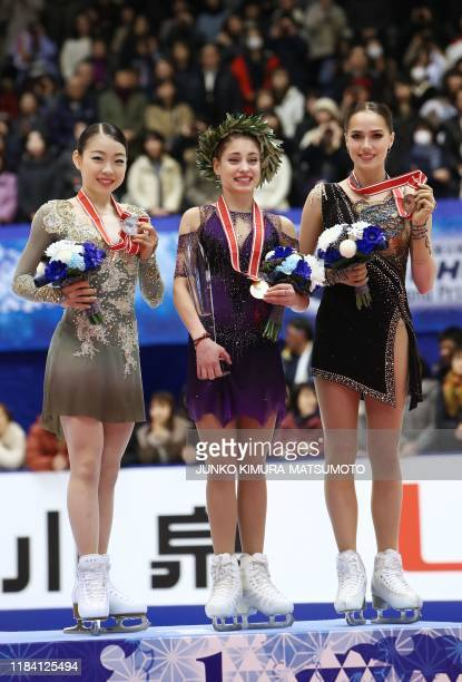 Japan's Rika Kihira Russia's Alena Kostornaia and Russia's Alina Zagitova pose for photographs after performing in the ladies free skating at the...