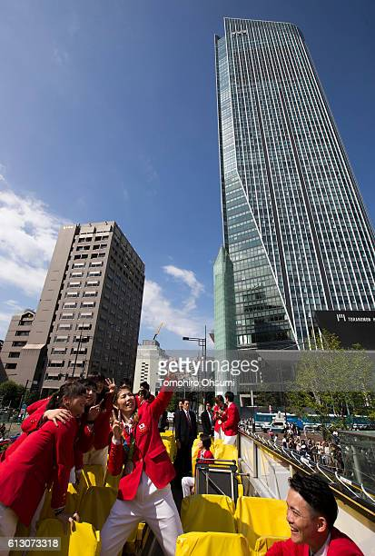 Japan's Rio de Janeiro Olympic team captain Saori Yoshida center takes a photograph with team members on the top of a double decker bus during the...