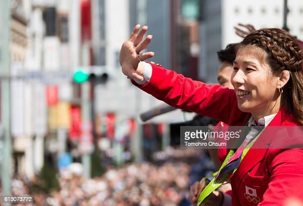Japan's Rio de Janeiro Olympic team captain Saori Yoshida waves from the top of a double decker bus during the Rio Olympics 2016 Japanese medalist...