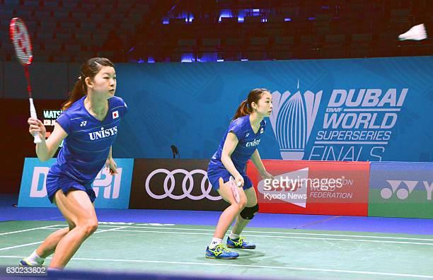 Japan's Rio Olympic goldwinning pair Ayaka Takahashi and Misaki Matsutomo play against China's Chen Qingchen and Jia Yifan in the women's doubles...