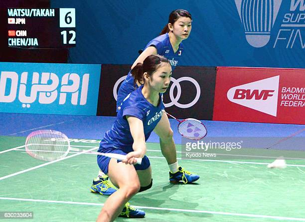 Japan's Rio Olympic goldwinning pair Misaki Matsutomo and Ayaka Takahashi play against China's Chen Qingchen and Jia Yifan in the women's doubles...