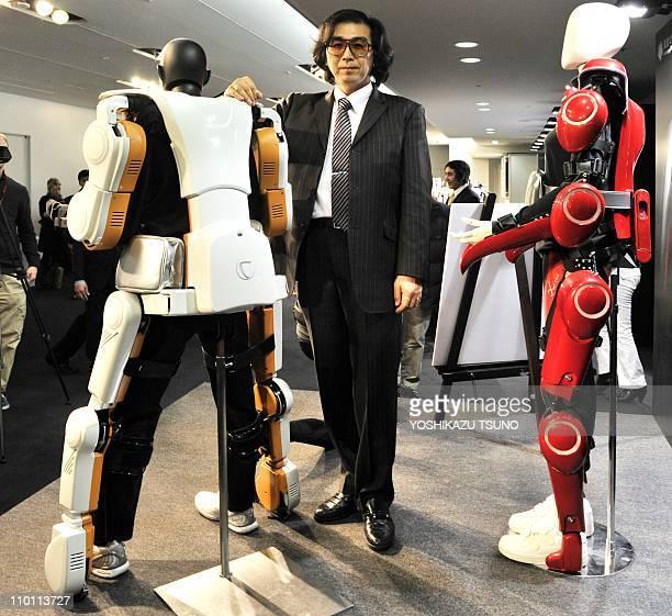 Japan's robot suit venture Cyberdyne president and Tsukuba University professor Yoshiyuki Sankai displays the fullbody type HAL robotic exoskeleton...