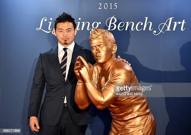 Japan's Rugby World Cup hero Ayumu Goromaru unveils his lifesize bronze statue during a ceremony of the Lighting Bench Art produced by Tokyo...