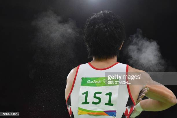 Japan's Ryohei Kato competes in the qualifying for the men's pommel horse of the Artistic Gymnastics at the Olympic Arena during the Rio 2016 Olympic...