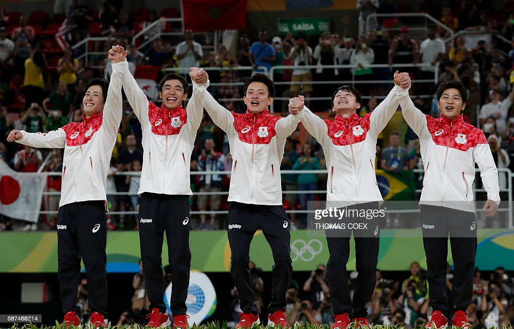 Japan's Ryohei Kato, Japan's Kenzo Shirai, Japan's Yusuke Tanaka, Japan's Kohei Uchimura and Japan's Koji Yamamuro pose with their gold medals on the podium of the men's team final of the Artistic Gymnastics at the Olympic Arena during the Rio 2016 Olympic Games in Rio de Janeiro on August 8, 2016. / AFP / Thomas COEX