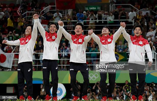 Japan's Ryohei Kato Japan's Kenzo Shirai Japan's Yusuke Tanaka Japan's Kohei Uchimura and Japan's Koji Yamamuro pose with their gold medals on the...