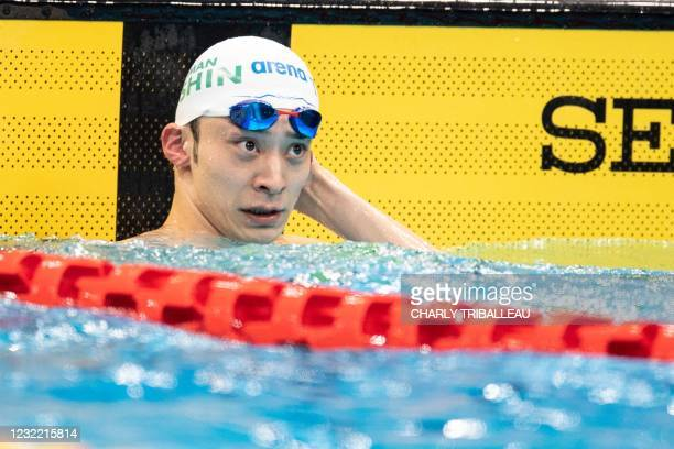 Japan's Ryosuke Irie reacts after winning the men's 50m backstroke final during the Japan National Swimming Championships, which doubles as a...