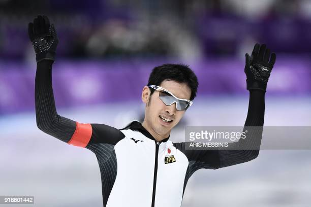 Japan's Ryosuke Tsuchiya celebrates winning the men's 5,000m speed skating event during the Pyeongchang 2018 Winter Olympic Games at the Gangneung...