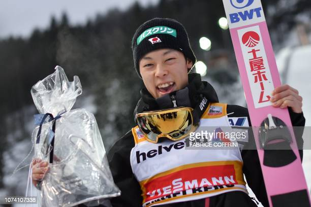 Japan's Ryoyu Kobayashi celebrates after winning the men's FIS Ski Jumping World Cup competition in Engelberg central Switzerland on December 16 2018