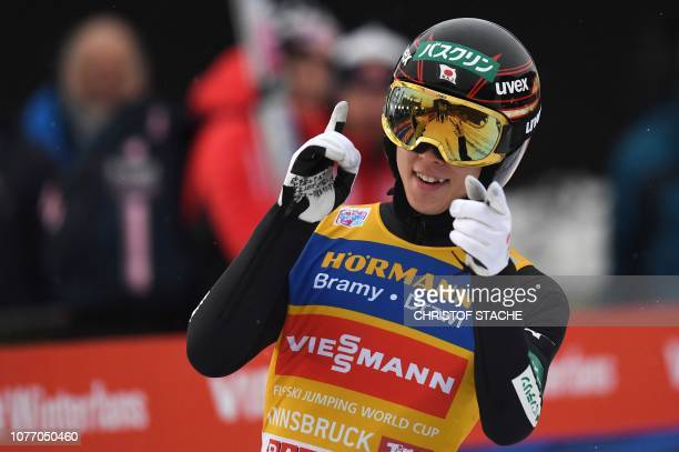 Japan's Ryoyu Kobayashi celebrates his victory after his final competition jump at the third stage of the FourHills Ski Jumping tournament in...