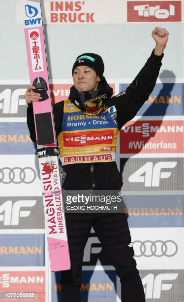 Japan's Ryoyu Kobayashi celebrates on the podium after the third stage of the FourHills Ski Jumping tournament in Innsbruck Austria on January 4 2019...